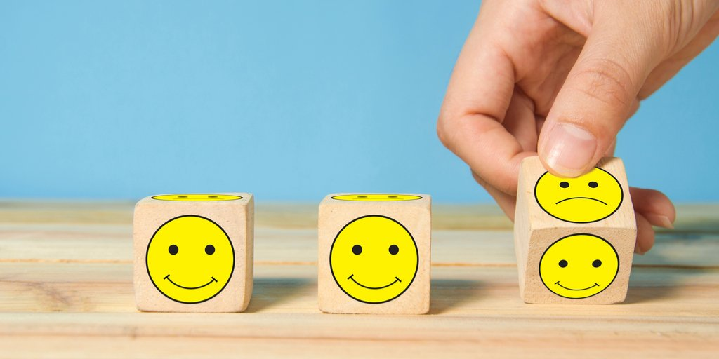 Smiley face blocks representing the importance of customer retention and satisfaction.