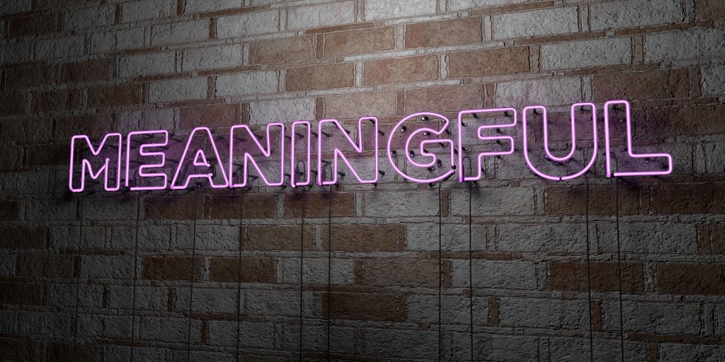 Purple fluorescent sign of the word meaningful, highlighting importance of meaningful brand.