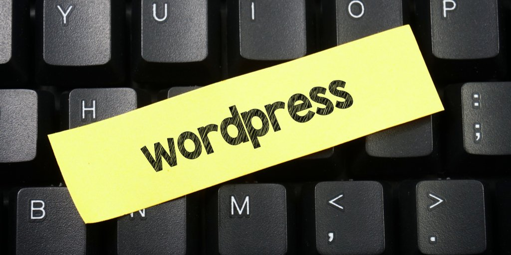 Wordpress written on paper resting on keyboard.
