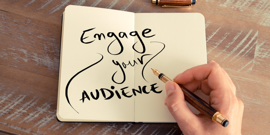 Engage your audience written in notebook with calligraphy pen.