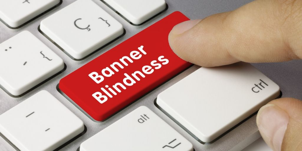 Finger pressing red banner blindness key.