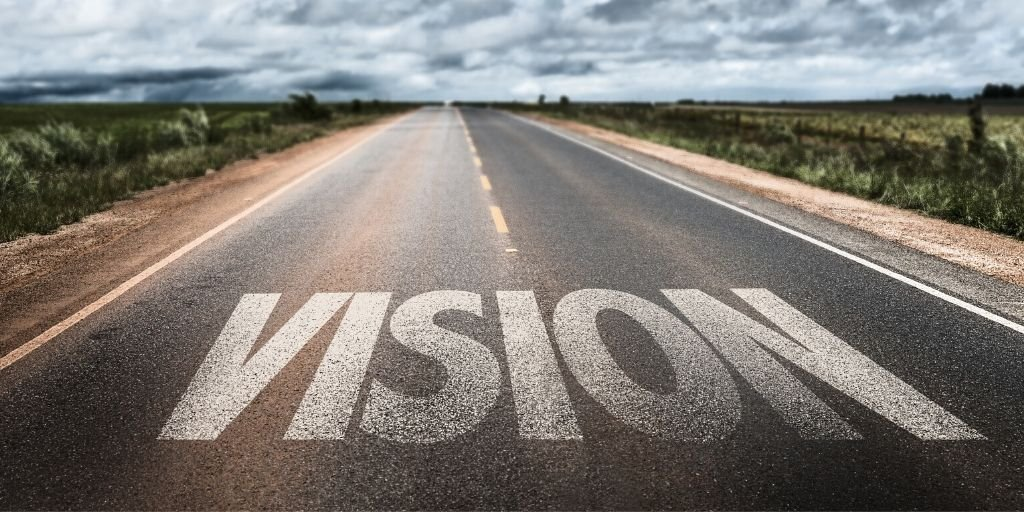 Vision written on rural road.