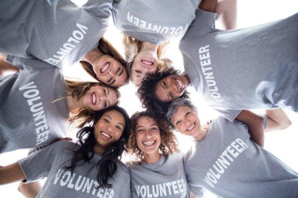 Team of volunteers in a huddle.