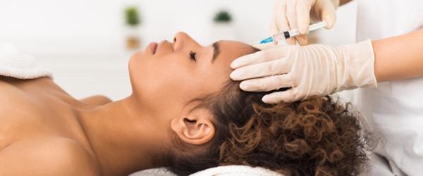 woman receiving botox treatment on forehead
