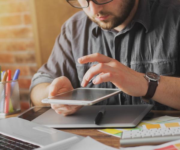 man checking web design on tablet